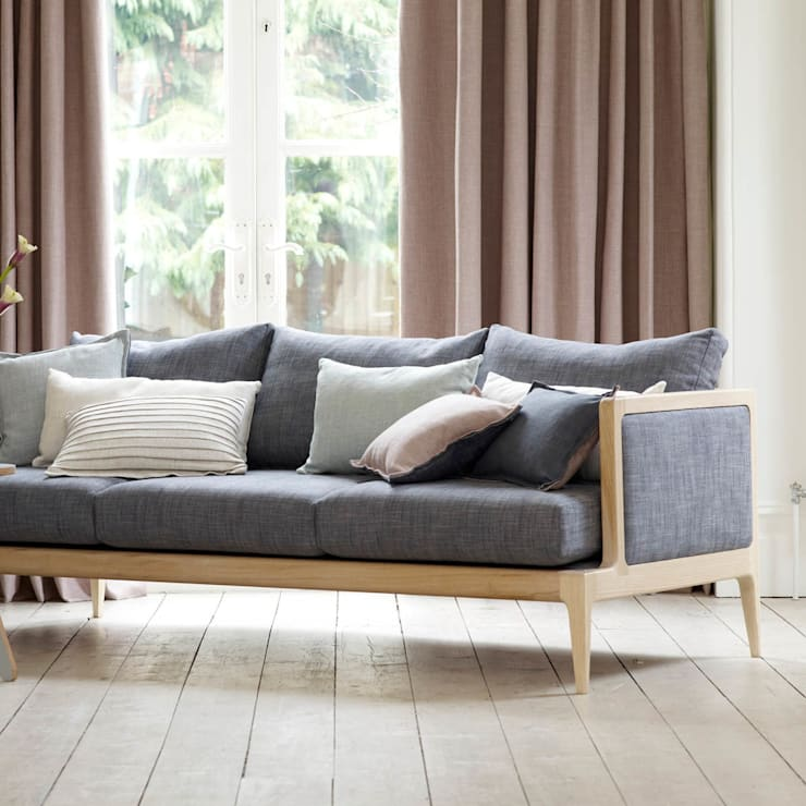 Frame Sofa:  Living room by Archer + Co
