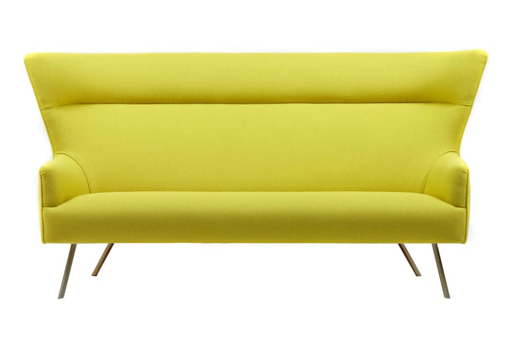 Tango Sofa:  Living room by Archer + Co