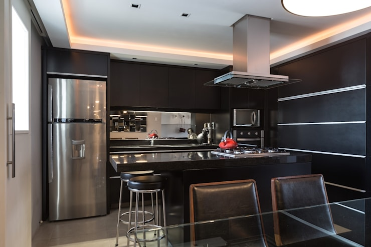 ACT | Estar, Jantar e Cozinha Integrados: Cozinhas  por Kali Arquitetura