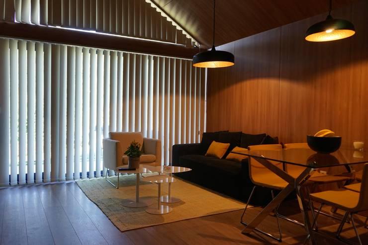 As cabanas dos Netinhos : Sala de estar  por Carlos Faria