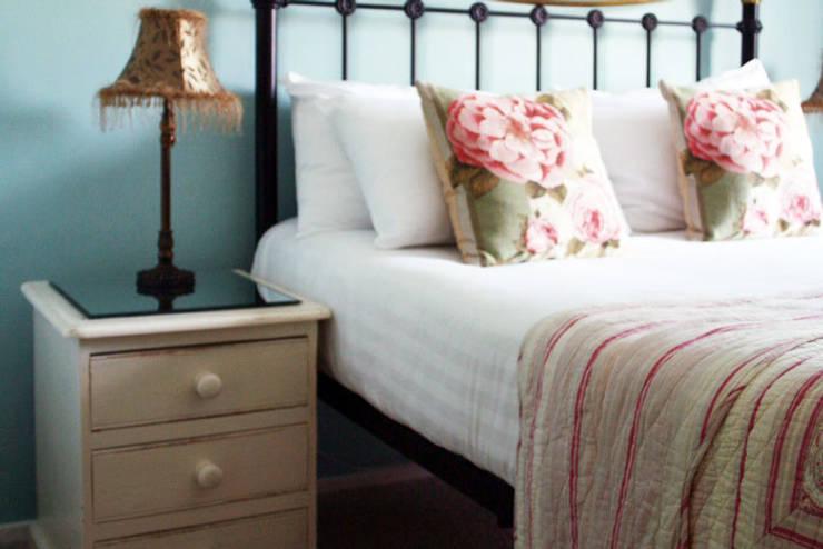 Bedside:  Bedroom by Alpine Furniture