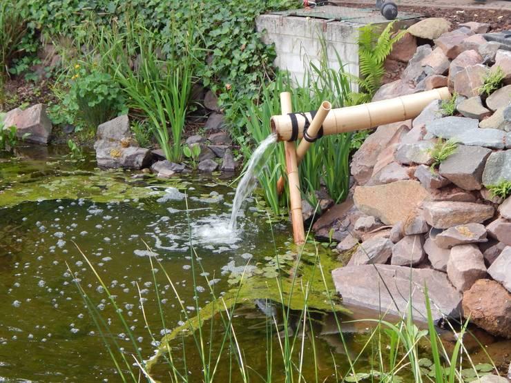 asiatischer Garten mit Teich und Felslandschaft:  Garten von jwgartendesign