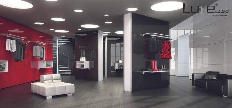 Oficinas y Tiendas de estilo  por ALVIC