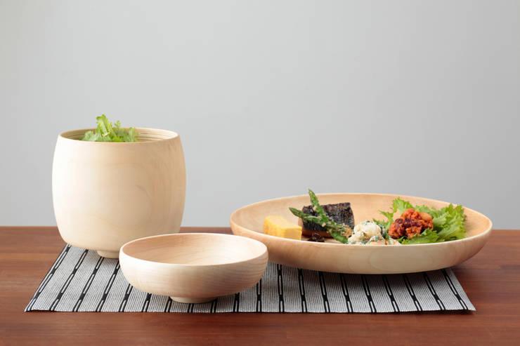 ナチュラル: KENICHIRO OOMORI MOVING DESIGNが手掛けたキッチンです。,