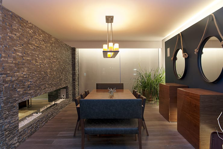Salas de jantar modernas por kababie arquitectos