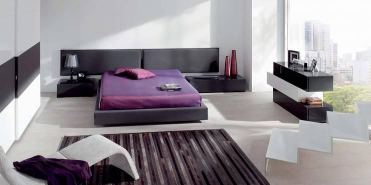Dormitorios emede: Dormitorios de estilo  de Muebles Begui