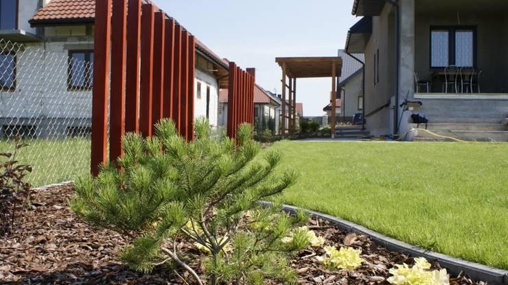 Ogród przydomowy: styl , w kategorii  zaprojektowany przez archiDENA architektura krajobrazu