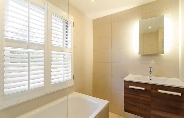London Townhouse: modern Bathroom by adventures in living