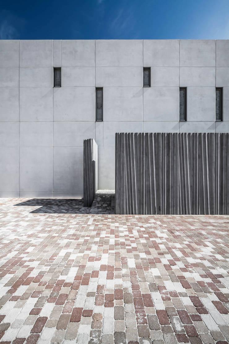 Materialidad del conjunto: Casas de estilo  de Hernández Arquitectos