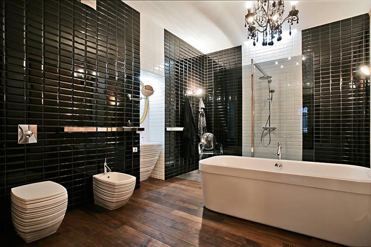 Baños de estilo  por VNUTRI