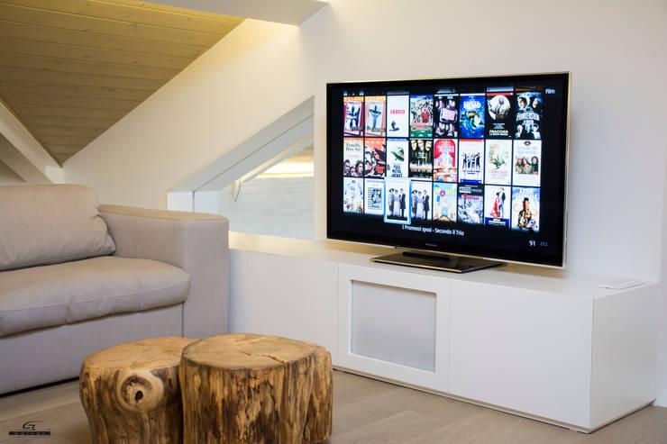 Projekty,  Pokój multimedialny zaprojektowane przez C.A.T di Bertozzi & C s.n.c