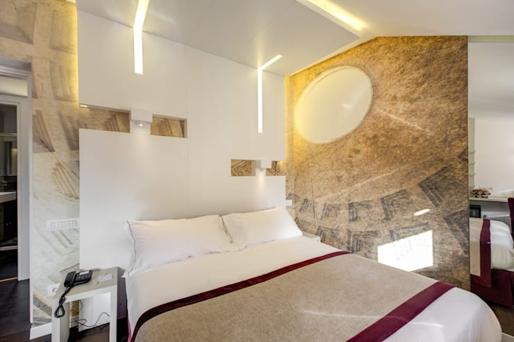 Camera letto: Camera da letto in stile  di Arch. Lamberto Grutter
