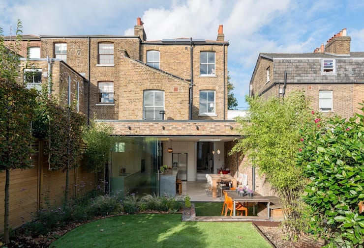 Peckham Victorian house wrap around extension:  Houses by Ar'Chic