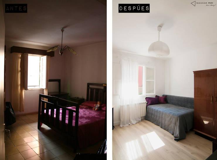 Habitación invitados-estudio:  de estilo  de emmme studio