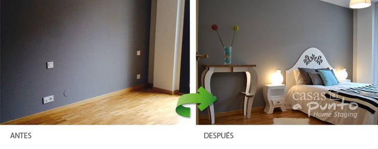Dormitorio. :  de estilo  de Casas a Punto home staging