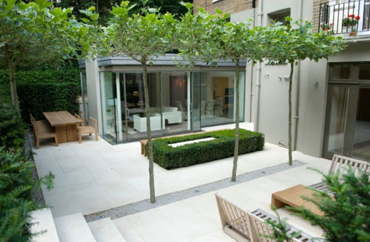Outdoor Living in Holland Park:  Terrace by PAD ARCHITECTS