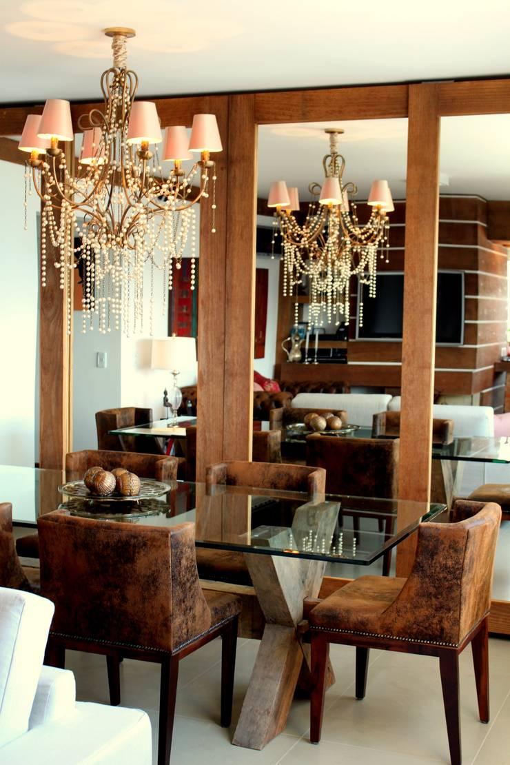 Dining room by Mariana M Simoes arquitetura conceitual,