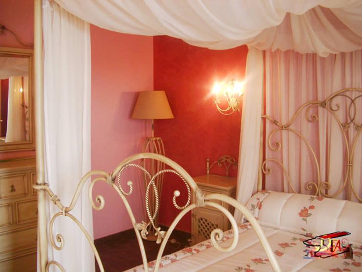 Camera da letto in stile  di Forja Arroyo