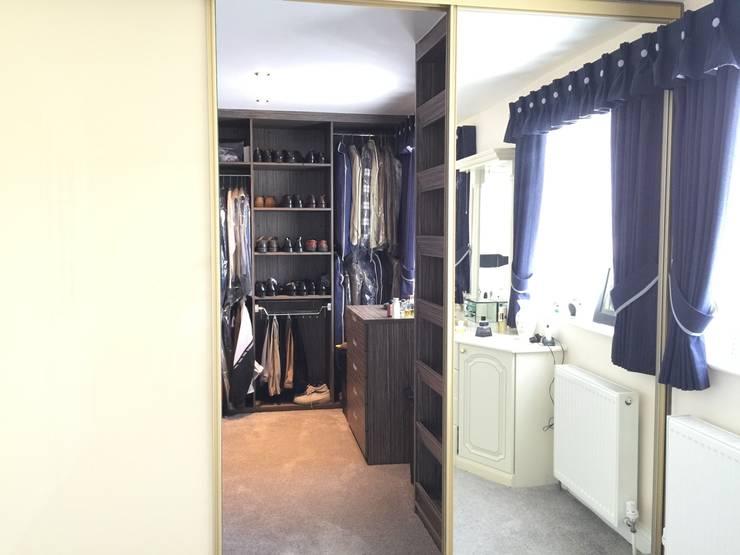 Grey-Beige Zebrano walk-in wardrobe with gold frame sliding doors:  Bedroom by Sliding Wardrobes World Ltd