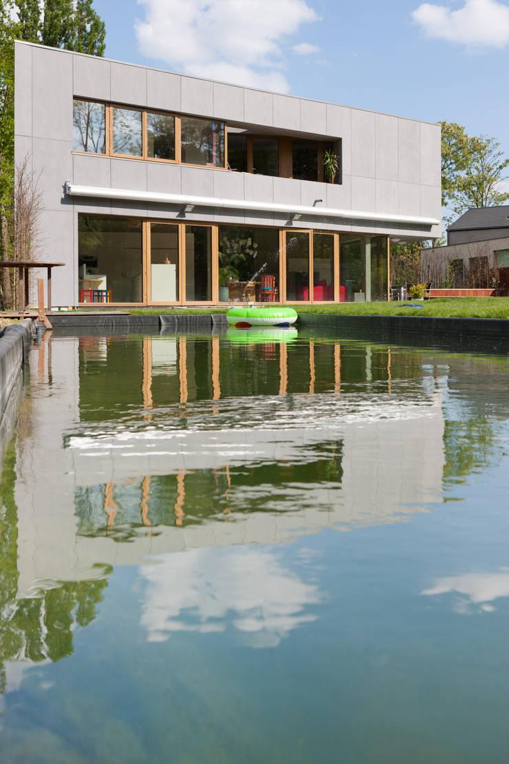 passiefwoning te Blanden:  Huizen door hasa architecten bvba, Modern