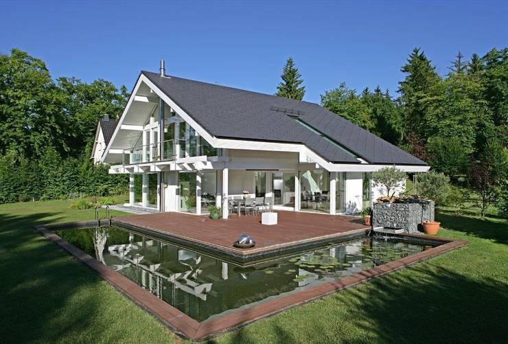 Projekty, nowoczesne Domy zaprojektowane przez DAVINCI HAUS GmbH & Co. KG