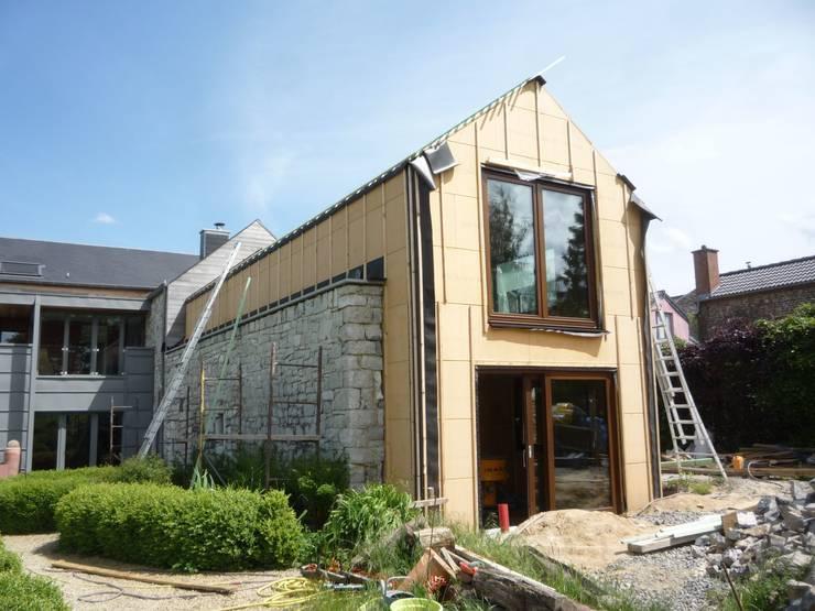 Vue de chantier:  de style  par helium3 positive architecture