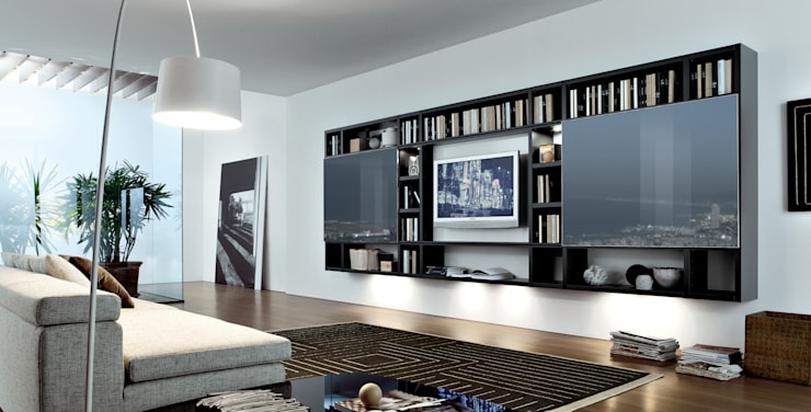 Wall hung TV unit and bookcase. Also with a glass sliding doors to revel TV:  Living room by Lamco Design LTD