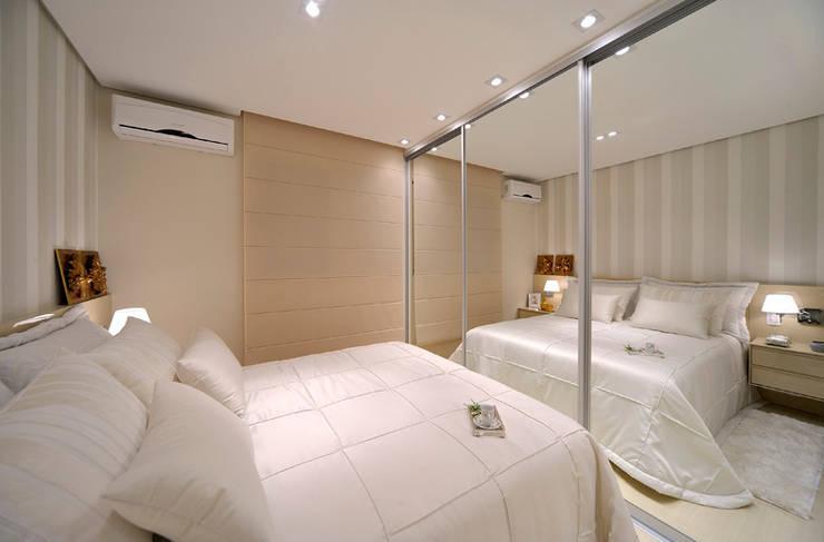 Apartamento integrado em Londrina: Quartos  por Evviva Bertolini
