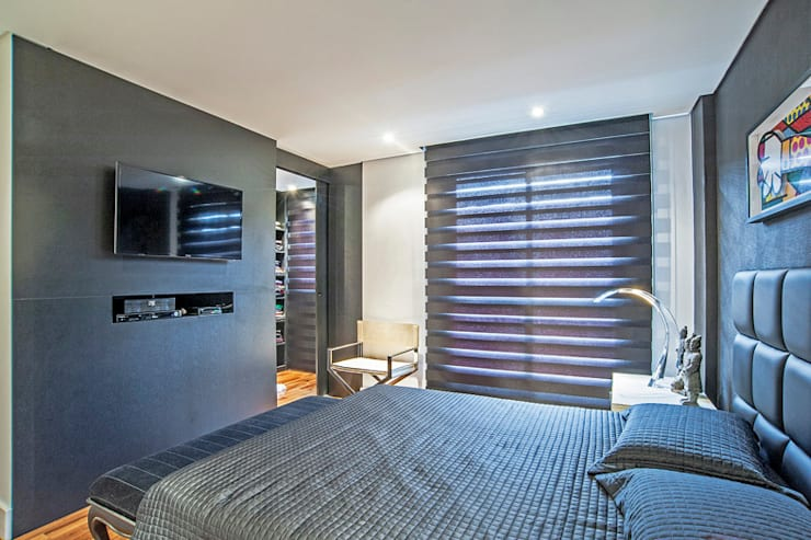 Apartamento masculino em Curitiba: Quartos  por Evviva Bertolini