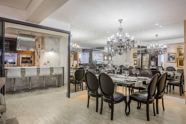 Apartamento em Cascavel: Salas de jantar  por Evviva Bertolini,