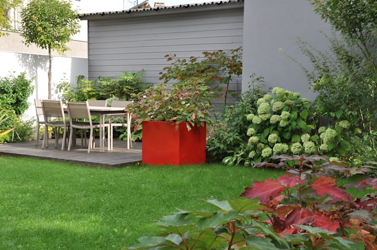 Jardines de estilo moderno de  GARDEN TROTTER
