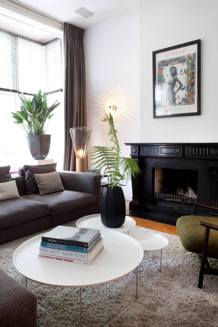 Familiehuis, Amsterdam Zuid:  Woonkamer door Binnenvorm, Eclectisch