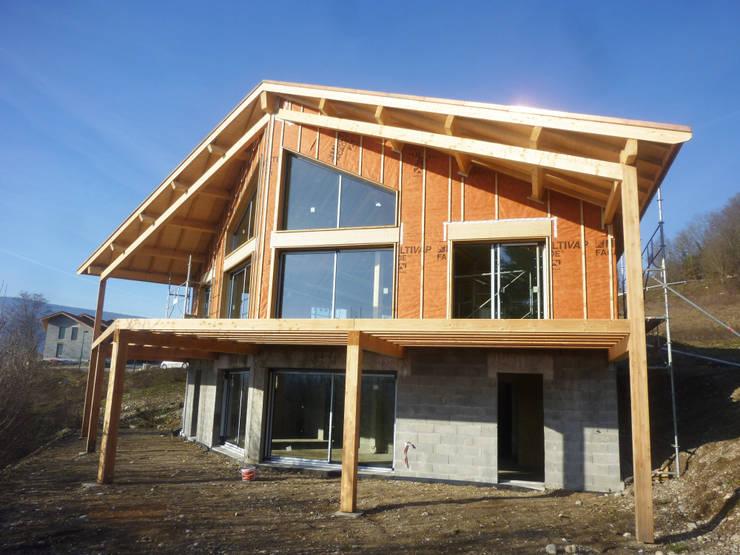 Maison BBC à Bellegarde-Sur-Valserine: Maisons de style  par Philippe GUILLOUX - BYG Architecte