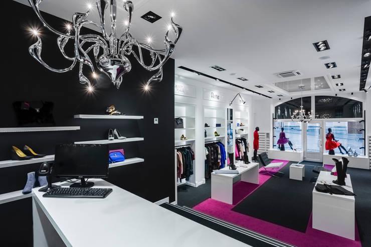 VIVALDI BOUTIQUE: styl , w kategorii Powierzchnie handlowe zaprojektowany przez DK architektura wnętrz
