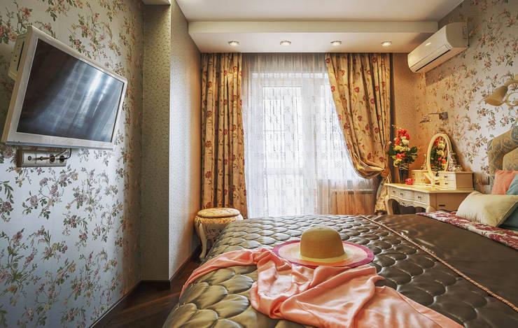 Уютная квартира в теплых  тонах: Спальни в . Автор – Ольга Макарова (Экодизайн) ,