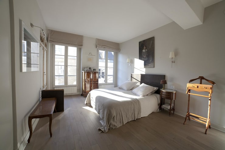 Camera da letto in stile  di STUDIO SANDRA HELLMANN