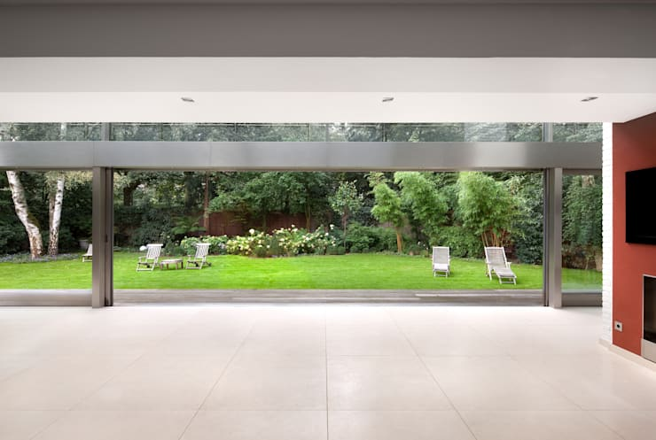 Innenraum / Außenraum: moderner Wintergarten von architekturbüro rettberg