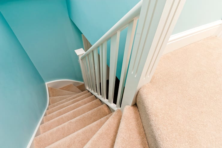 over existing spiral stairs:  Corridor & hallway by A1 Lofts and Extensions