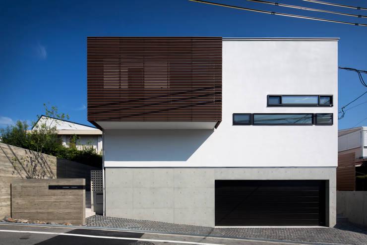 Casas de estilo  por  井上久実設計室,