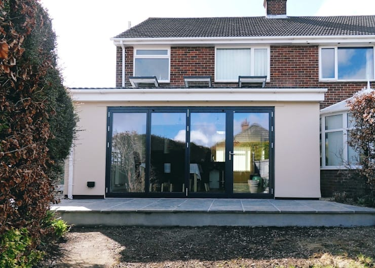 After works - exterior shot with bifold doors closed:  Houses by Rogers and Jones Architects