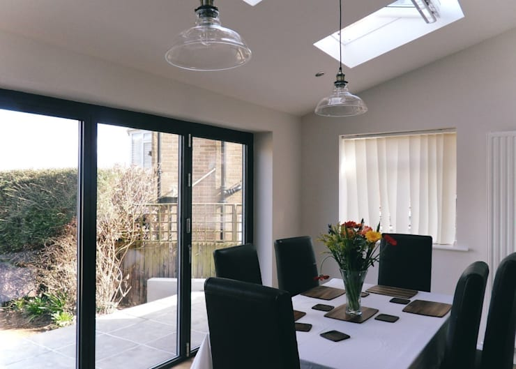 Dining room, velux and folding door system:  Dining room by Rogers and Jones Architects