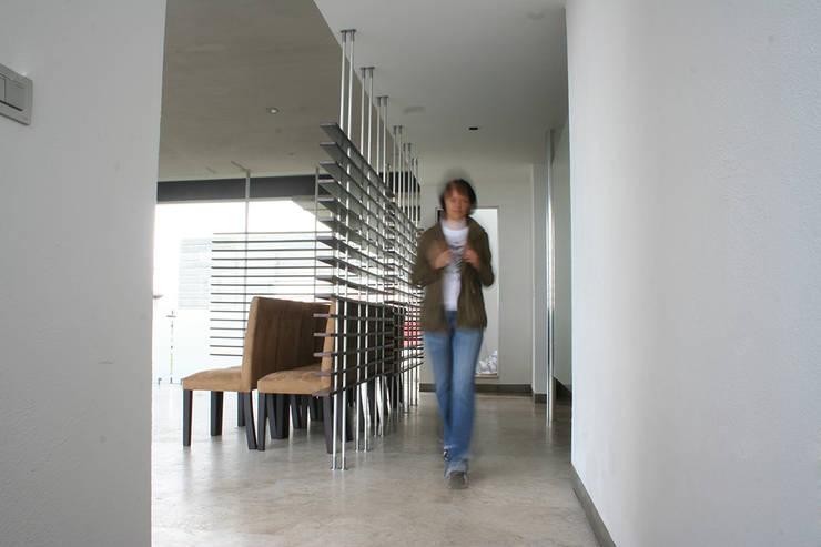 Casa Aburto: Salas de estilo  por VG+VM Arquitectos