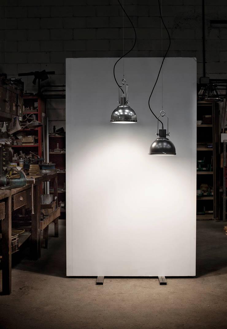 Mileni 841/10: Comedor de estilo  de Jou Diseño & Luz