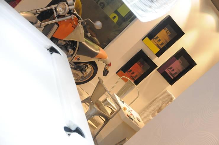 Sala de Jogos: Garagens e edículas  por Renata Amado Arquitetura de Interiores,Industrial
