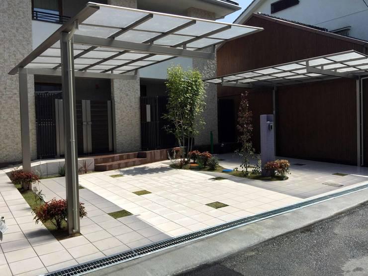 シンプルにデザインする ということ: sotoDesign  株式会社竹本造園が手掛けた家です。,モダン