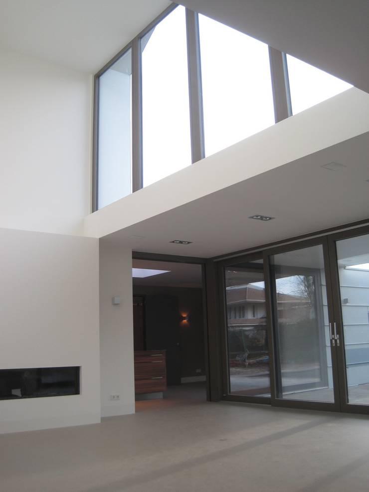 woonkamer:  Woonkamer door Villa Delphia, Modern