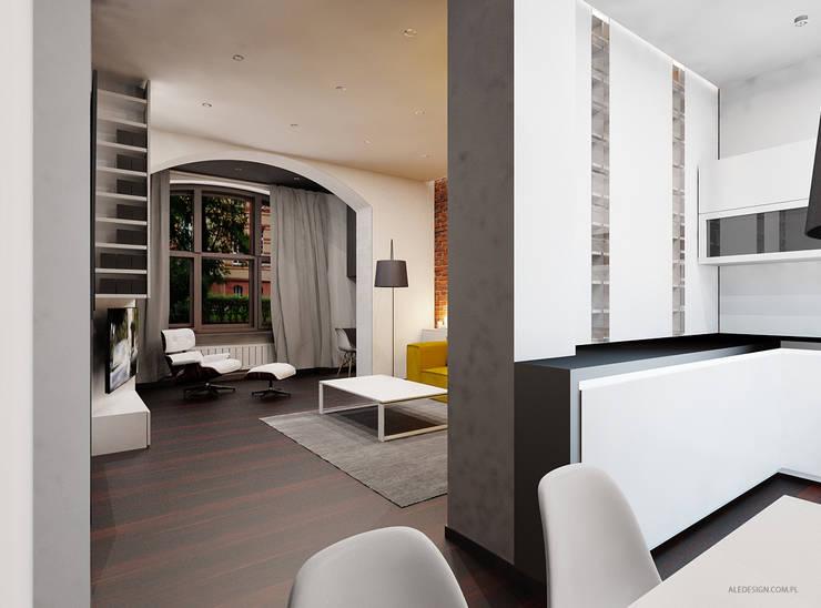 Prze aranżowanie salonu ze ścianą z luksferami i cegłą: styl , w kategorii Salon zaprojektowany przez Ale design Grzegorz Grzywacz