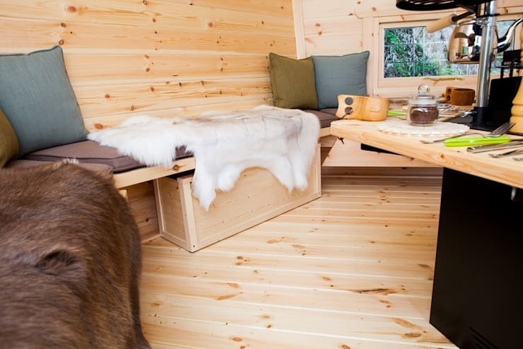 Seating and rugs inside a 10m² Barbecue Cabin in a Derbyshire garden. :  Garden by Arctic Cabins