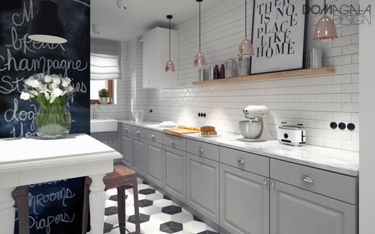 Cocinas de estilo industrial por DOMagała Design