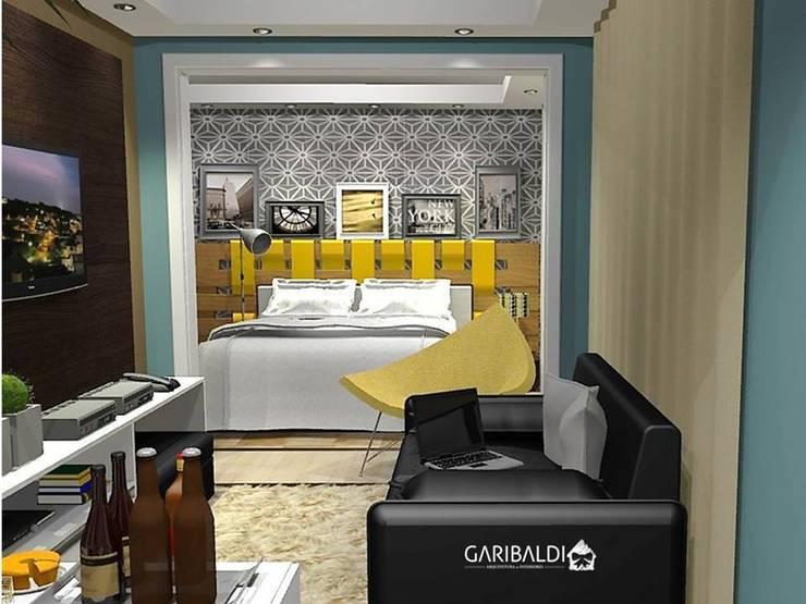 Apartamento de um jovem casal : Salas de estar  por Garibaldi - Arquitetura . Interiores